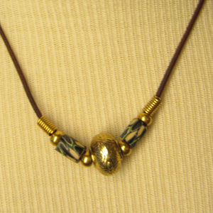 Hand made necklace.  Brass, leather and clay
